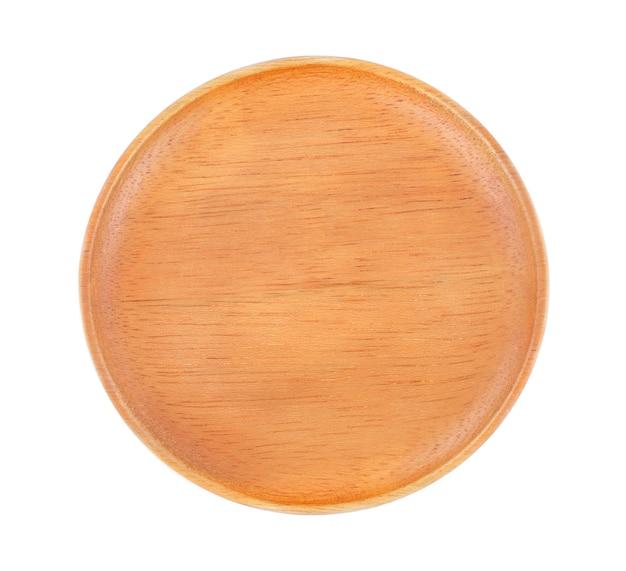 Деревянная тарелка на белом фоне