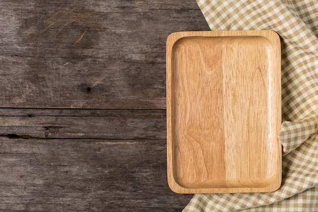 Wood plate on wooden background