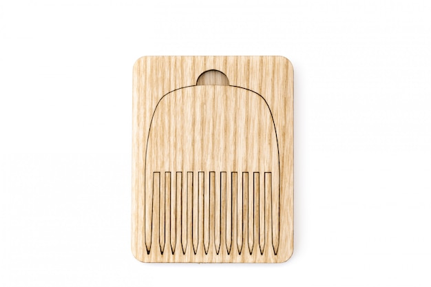 Wood pocket hair comb in a case.