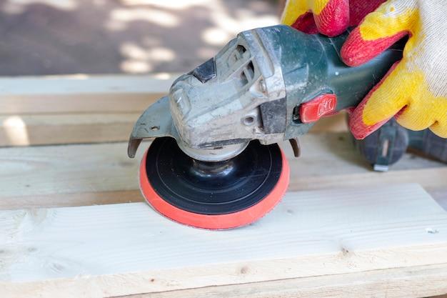 Wood polishing. wood grinder. surface treatment