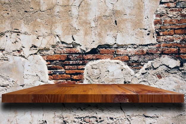 Wood shelf on old brick wall texture background.