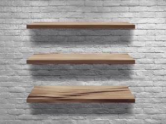 Wood shelves on white brick wall