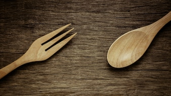 Wood spoon and fork on old wooden desk. - vintage style.