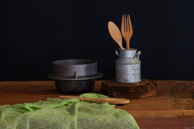Wood spoon and fork in cup