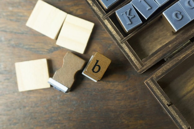 Wood stamp alphabet close up image for background.