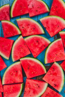 Wood surface with watermelon portions