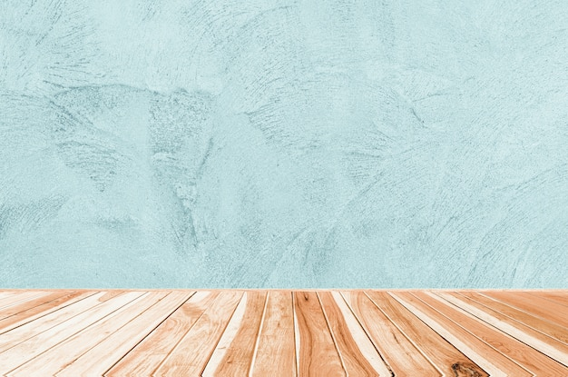 Wood table on abstract grunge decorative rough uneven navy blue stucco wall background:  interior design or montage display your product