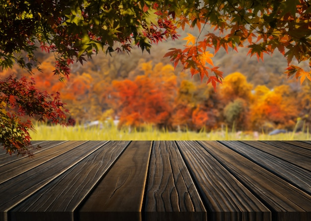 Wood table in autumn landscape with empty copy space for product display mockup.