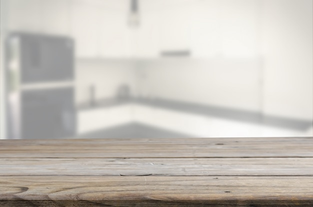 Wood table background with blur kitchen