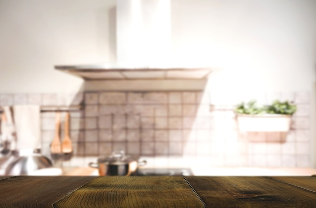 Wood table on blur interior of kitchen background