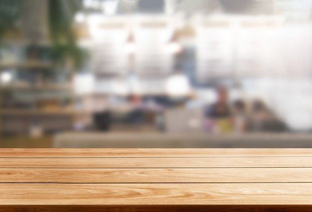 Wood table in blurry background of modern restaurant room or coffee shop for product display