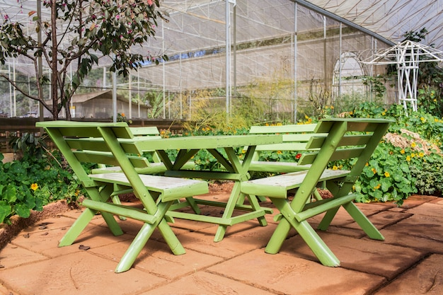 Wood table and chair table in garden