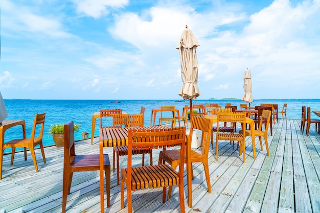 Wood table and chair with sea view in maldives