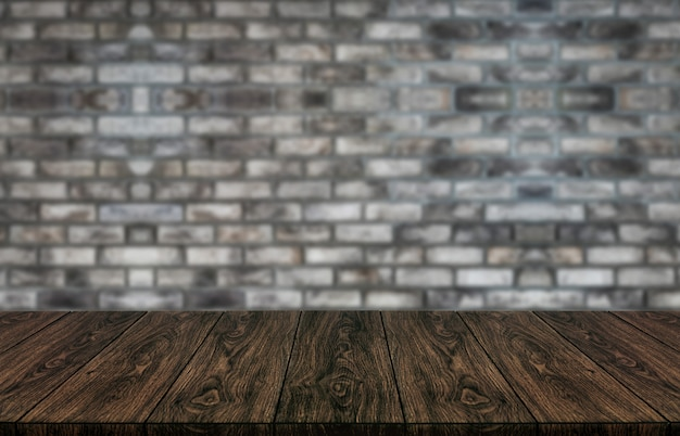 Wood table in front of brick wall blur background.