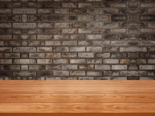 소박한 벽돌 벽 앞 나무 테이블 테이블에 빈 복사본 공간 배경 흐림.