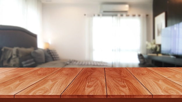 Wood table in modern home room decoration.