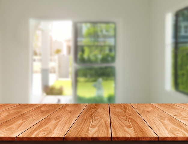 Wood table in modern home room interior with empty copy space on table for product display