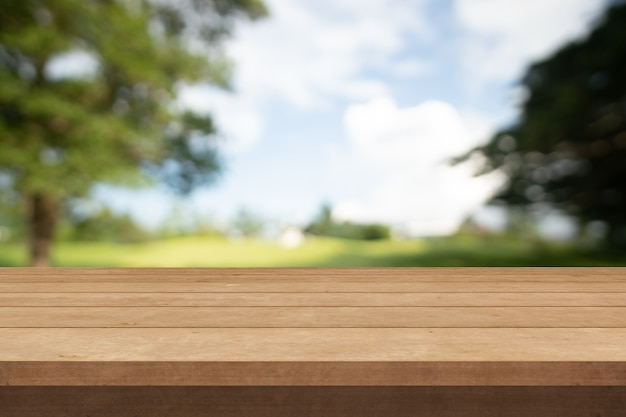 Wood table and outdoor garden blur background