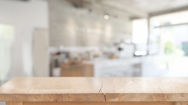 Wood table for product display montage in blurred cafe