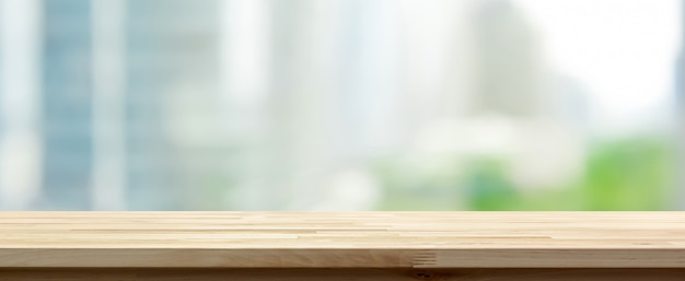 Wood table top on abstract blurred cityscape background