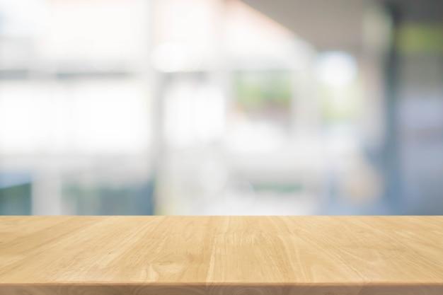 나무 테이블 상단 및 흐린 bokeh 배경-디스플레이에 사용하거나 제품을 몽타주 할 수 있습니다.