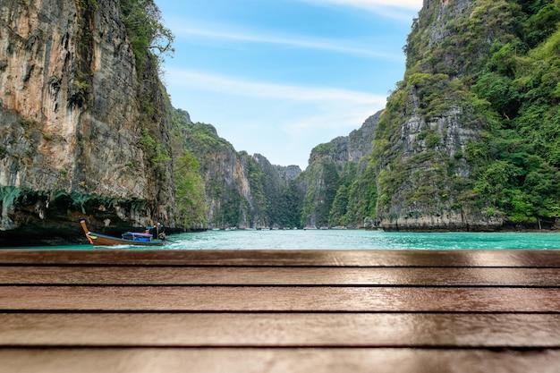 Wood table top on beautiful pileh lagoon at phi phi leh background