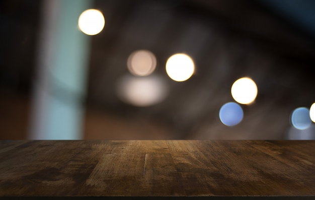 Wood table top in blur background room interior
