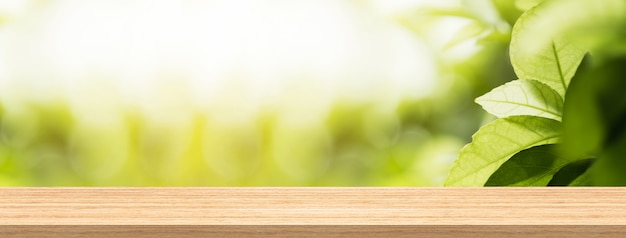 Wood table top and blur natural background in garden for product and display montage banne