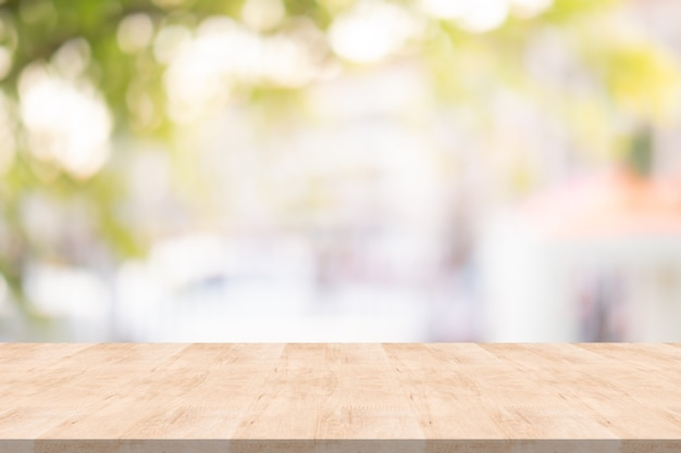 Wood table top on blurred background from garden, space for montage your product