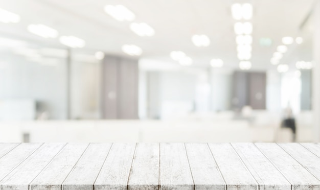 Wood table top and blurred bokeh office interior space background