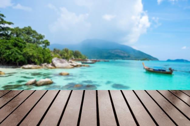 Wood table top on blurred ko lipe tourist attraction wonderful