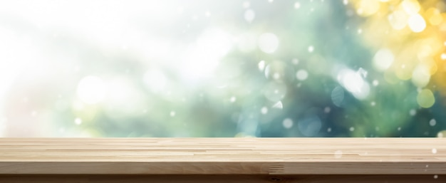 Wood table top on bokeh background from decorated christmas tree, panoramic banner