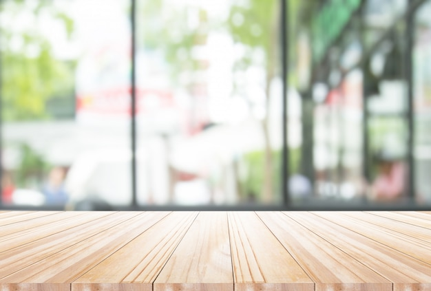 Wood table top on disfocus kitchen  background