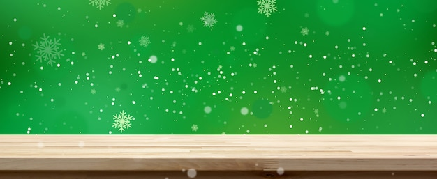 Wood table top on green bokeh background with white snow, panoramic banner