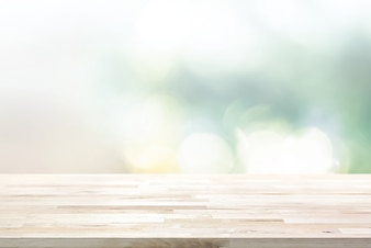 Wood table top on  blur abstract white green bokeh background