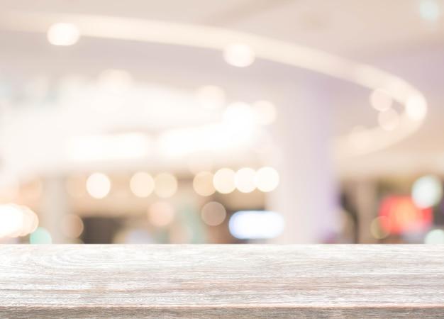 나뭇잎 쇼핑몰 배경으로 흐림에 나무 테이블 탑-디스플레이에 사용하거나 제품을 몽타주 할 수 있습니다