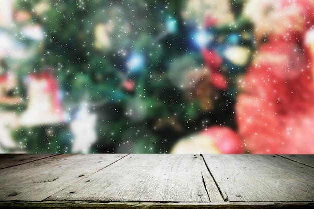 Деревянный стол на боке рождество фона.