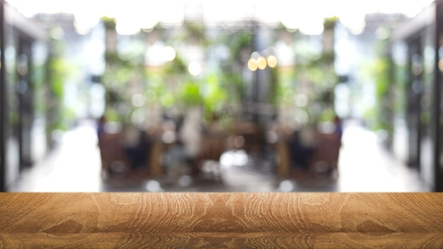 Wood table top on outdoor cafe for banner background
