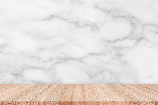 Wood table top on white marble texture background can be used for display or montage your