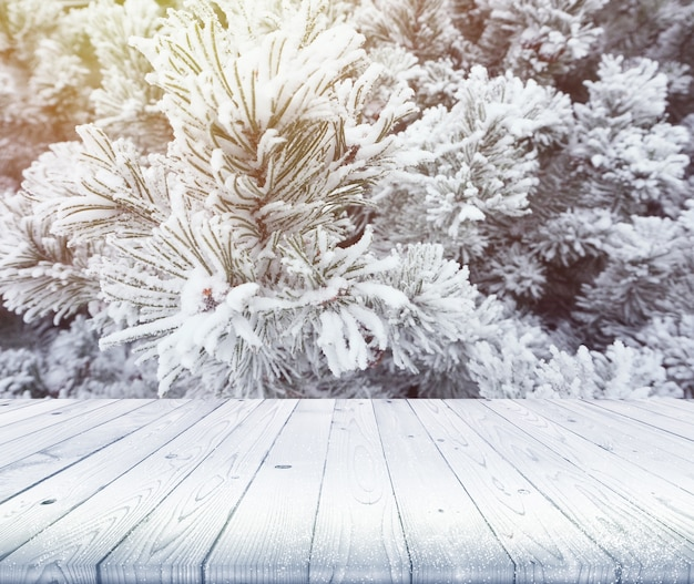 Wood table top on winter background, use for display of your products or content