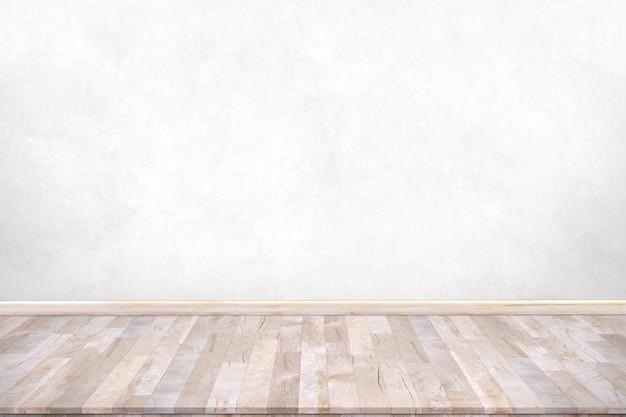 Деревянная столешница с предпосылкой бетонной стены. используется для размещения продукта или монтажа.