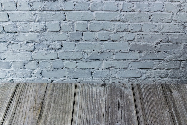 Wood table and a white brick wall