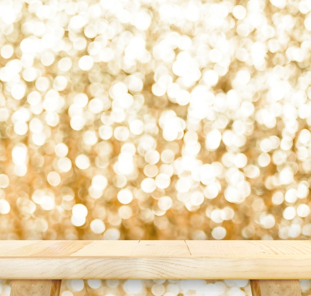 Wood table with bokeh golden sparkling background,empty room for display your product