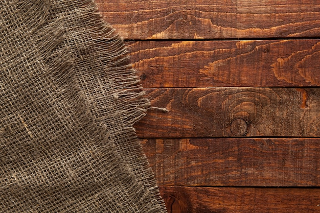 Wood table with old burlap cloth
