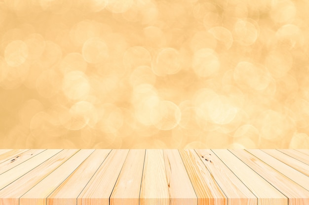 Wood table or wood floor with abstract gold bokeh and fireworks background for product display