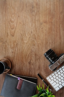 Wood table workspace of hipster minimal with gadget and copy space