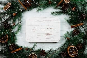 Wood tablet between fir branches