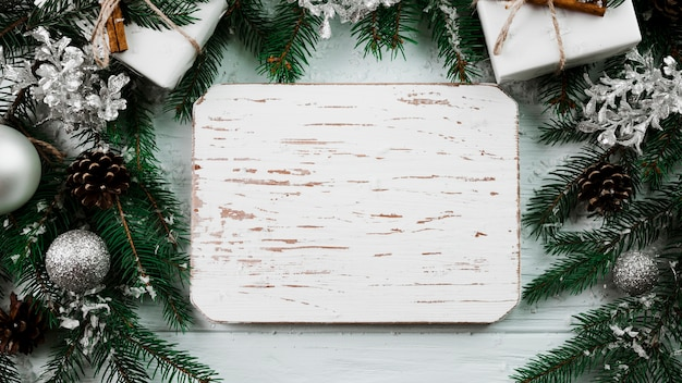 Wood tablet between christmas branches