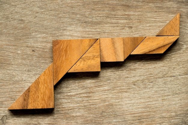 Wood tangram puzzle in gun shape background