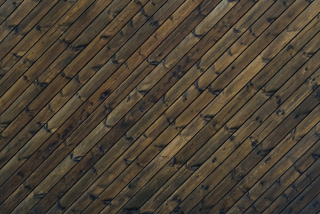 Wood texture background dark brown color 45 degree. texture of old wooden planks at an oblique angle.